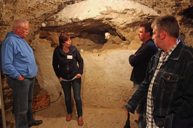 In a cave at Colditz castle. On the background the entrance of a hand digged escape tunnel